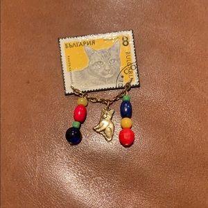 "Jewelry - Cat ""postage stamp"" pin"